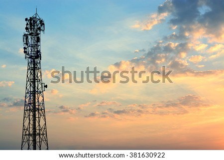 Mobile phone tower silhouette with evening sky. - stock photo
