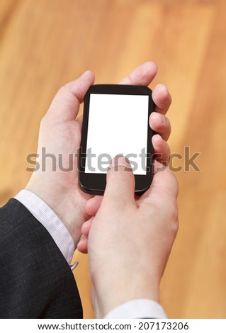 mobile phone with cut out screen in businessman hands close up - stock photo