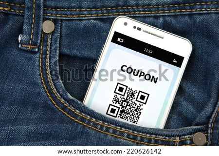 mobile phone with discount coupon in jeans pocket - stock photo