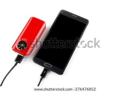 mobile phone with red power bank Recharging isolated on white background - stock photo