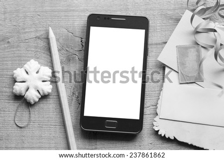 Mobile phone, wooden pencil and the Christmas elements in the vintage style - stock photo