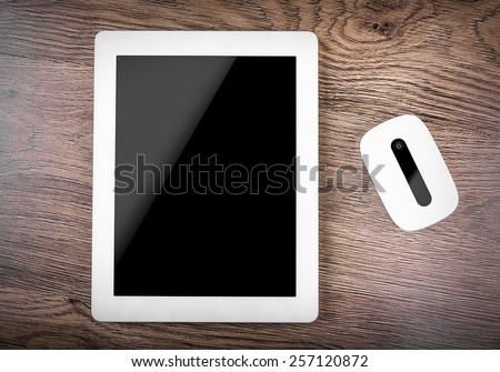 Mobile router with tablet pc. 3G or LTE network concept. On wooden table. - stock photo