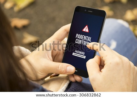 mobile security concept: woman holding a 3d generated smartphone with parental control on the screen. Graphics on screen are made up. - stock photo