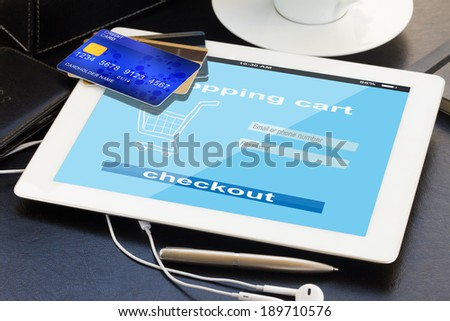 mobile shopping  - checking out in virtual shop on tablet PC - stock photo