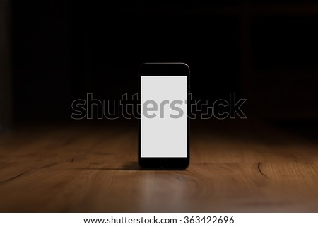 Mobile smart phone with blank screen on the table - stock photo