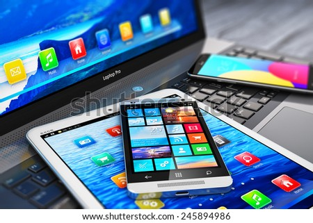 Mobility and modern internet business communication technology concept: macro view of laptop or notebook, tablet computer PC and touchscreen smartphones with color interfaces with icons and buttons - stock photo