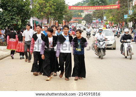 Moc Chau, Son La, Vietnam: September 1, 2014, an unidentified group of people walking on the street when they wear traditional costume of H'mong ethnic