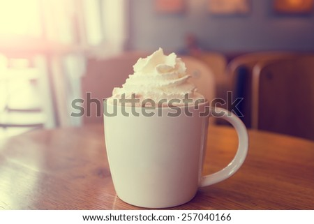 Mocha coffee with whipped cream made with Vintage Tones - stock photo