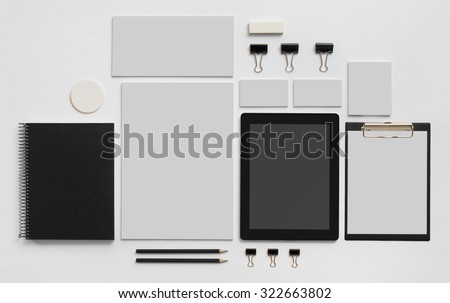 Mock-up business template with shopping bag, mobile tablet and envelopes. Gray background. - stock photo