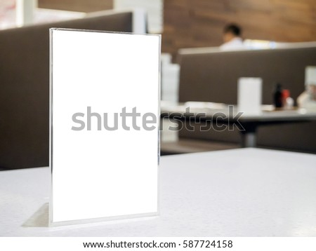 mock up menu frame on table in the cafe restaurant acrylic stand with white paper