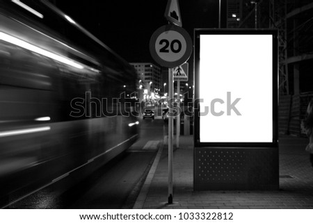 mock up of a light advertising box at a bus stop at night.