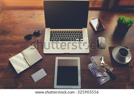 Mock up of business person desktop with luxury accessories and distance work tools, laptop computer and digital tablet with blank copy space for text message or information content, start up concept