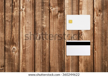 Mock-up of credit card on wooden table - stock photo