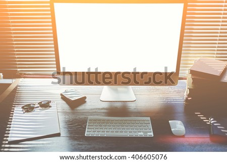 Mock up of office desktop with accessories and work tools, pc computer with blank copy space screen for your promotional content,keyboard with mouse,sunglasses,clear notepad, modern hipster work space - stock photo
