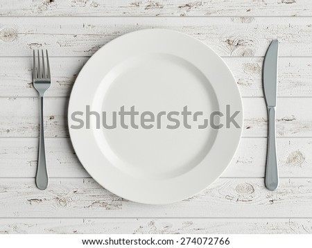 Mock up plate on white wooden table - stock photo