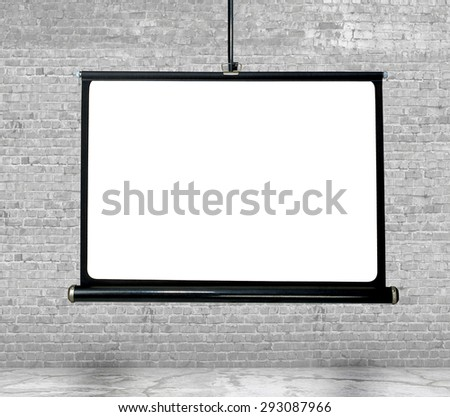 mock up projection screen over white brick wall - stock photo