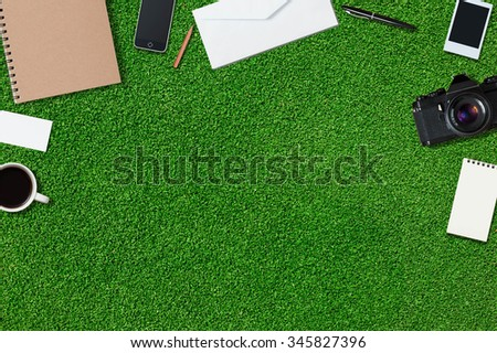 Mock up template of traveling equipment with copy space on green grass - stock photo