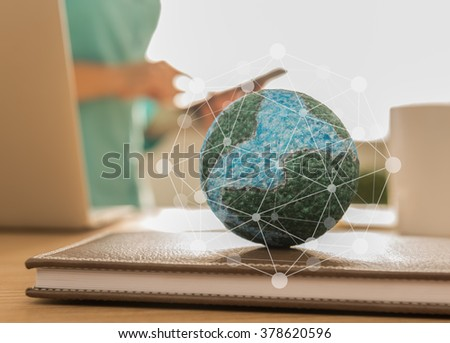 mock up the globe with digital social media network on notebook at office background. - stock photo