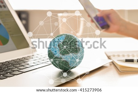 Mock up the globe with digital social media network on notebook at office background. Concept of Connection, Communication, Technology. - stock photo
