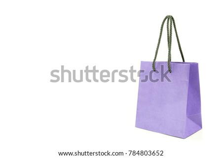 Mock up violet Paper Bag for shopping isolated on white.