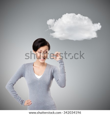 Mocking woman gestures small amount, isolated on grey background with cloud - stock photo