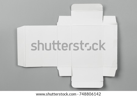 Mockup blueprint template white paper box stock photo 748806142 mockup blueprint template of white paper box packaging on gray background old cardboard with die malvernweather Image collections