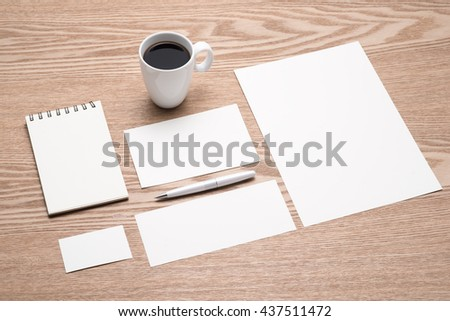 Mockup business brand template on desk. Set of stationery with a black notepad. - stock photo