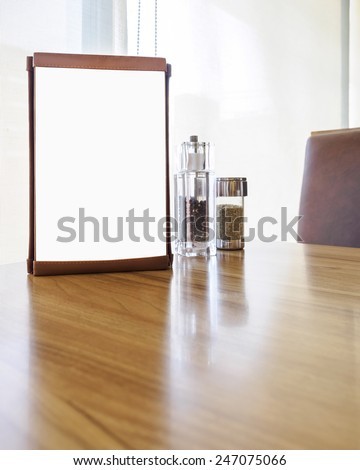 Mockup Menu frame on Table in restaurant cafe shop with Clipping path for edit - stock photo