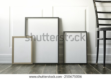 mockup of blank three frame poster on the floor - stock photo
