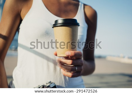 mockup of coffee cup in girl hands - stock photo