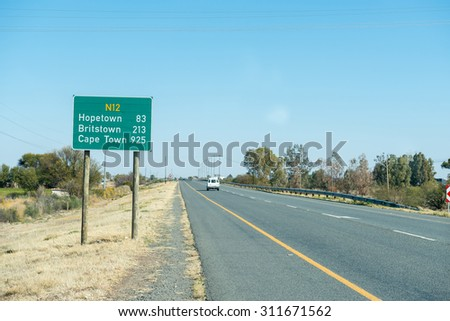 MODDERRIVIER, SOUTH AFRICA - AUGUST 9, 2015: Distance road sign at Modderrivier (Mud River) in the Northern Cape Province of South Africa
