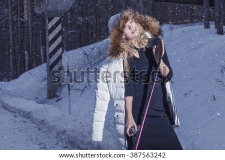 Model beautiful woman in fashionable clothes and accessories for skiing on the snowy skiing in winter - stock photo
