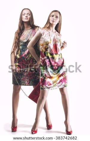Model beautiful women in bright dresses in full length isolated on white background - stock photo
