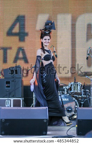 "Model, display designer dress. St. Petersburg, Russia - 12 August, 2016. Beauty contest ""Miss St.Petersburg Harley Days 2016"" at the annual festival Harley Davidson in St. Petersburg."