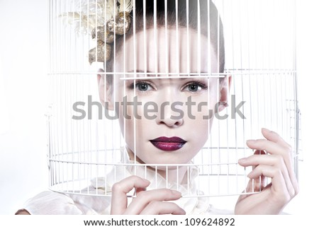 model face in cage on white background - stock photo