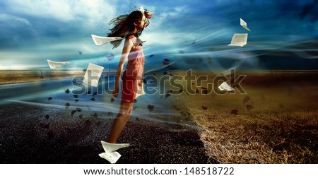 Model girl stay against a wind. dramatic landscape portrait - stock photo
