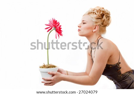 Model Having Fun With A Pink Flower - stock photo