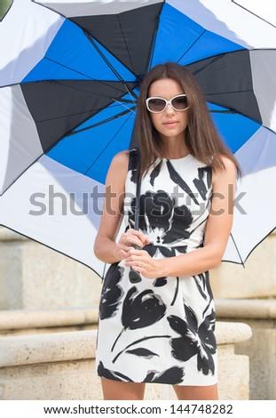Model holding a large umbrella - stock photo