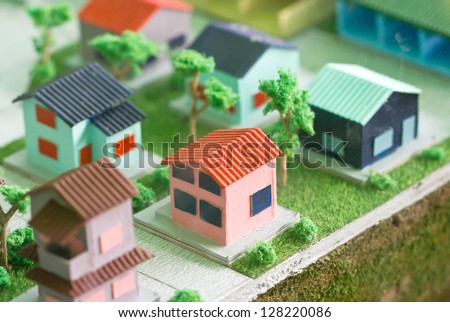 Model home on grass. - stock photo