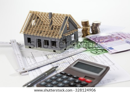 Model house calculator euro notes on blueprint, planning construction