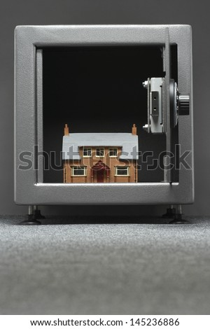 Model house in safe - stock photo