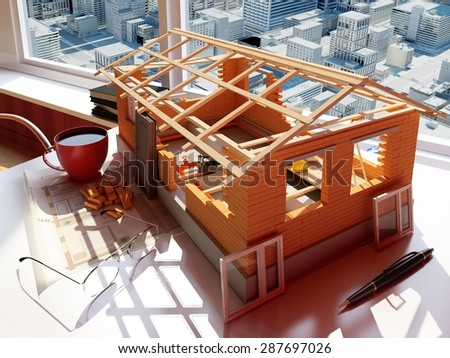 Model house on the table. - stock photo
