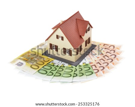 model house , tools and banknotes ,isolated white background ,concept of buying a house - stock photo