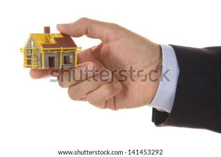 model house under construction in broker hand - stock photo