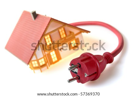 Model house with red plug - stock photo
