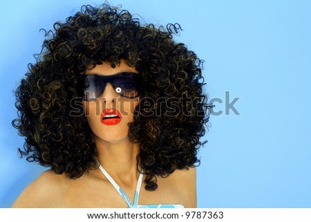 Model in a big afro wig - stock photo