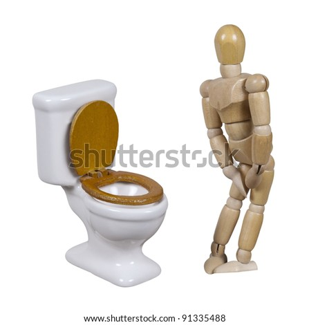 Model in need to relieve himself next to a porcelain toilet with wooden seat - path included - stock photo
