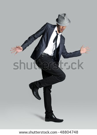 Model is happy and lets it show with his jazz hands - stock photo
