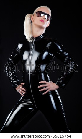 Model is wearing latex clothes and posing