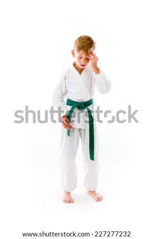 model isolated on plain background confused headache - stock photo